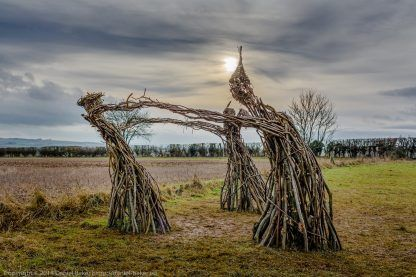 wicker witches standing in a circle with the sub just behind ones head